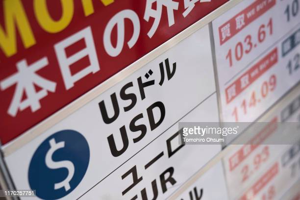 Sign listing the exchange rate of the U.S. Dollar against Japanese yen is displayed outside a currency exchange store on August 26, 2019 in Tokyo,...