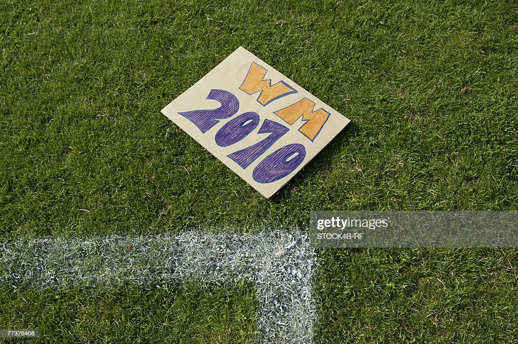 WM 2010 sign lying on grass : Stock Photo
