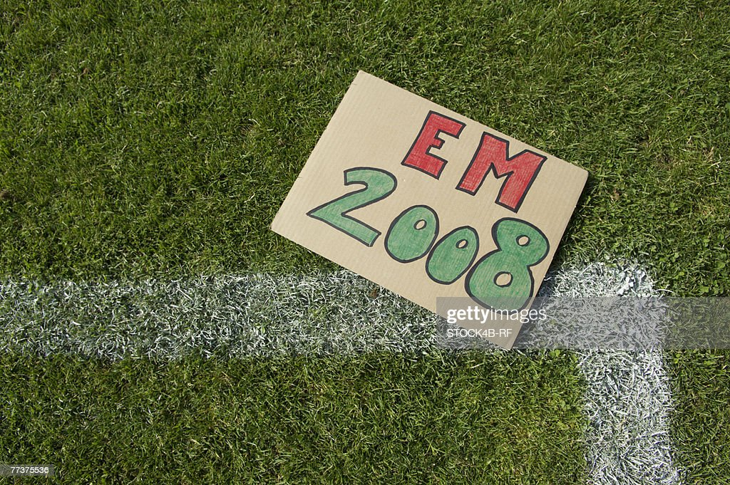 EM 2008 sign lying on soccer field : Photo
