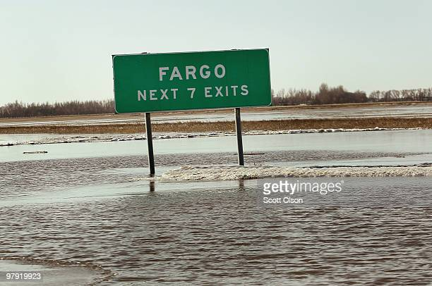 A sign marking the Fargo exits along Interstate 29 sits in flood water March 21 2010 near Fargo North Dakota The Red River crested at Fargo today at...