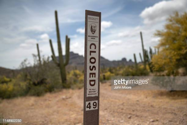 A sign marks a trail entrance at the Organ Pipe Cactus National Monument on May 10 2019 near Ajo Arizona The number of immigrant deaths in the area...