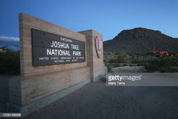 Sign marks an entrance to Joshua Tree National Park one day after the park reopened after being closed for two months due to the coronavirus pandemic...