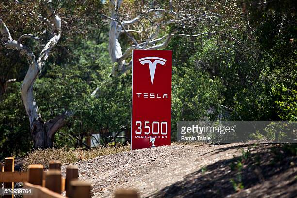 A sign marks the entrance of Tesla Motors Inc headquarters in Palo Alto CA on July 23 2014 Tesla Motors is the maker of highend electric cars