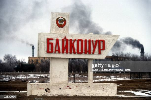 A sign marks the entrance to the town of Baikonur on March 16 in Baikonur Kazakhstan Baikonur located in the steppes of Kazakhstan was constructed to...