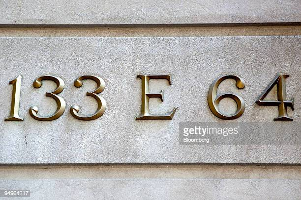 A sign marks the exterior of 133 East 64th Street a building that houses the penthouse apartment belonging to Bernard and Ruth Madoff in New York US...
