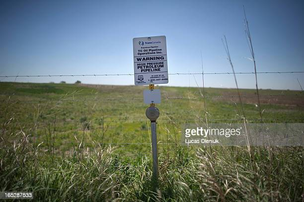 A sign marks the ground covering TransCanada's Keystone I pipeline outside of Steele City Nebraska The Keystone XL pipeline is set to meet the first...
