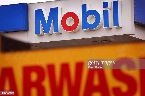 A sign marks the location of a Mobil gas station April 30 2009 in Chicago Illinois Exxon Mobil Corp today reported its lowest profit in five years...