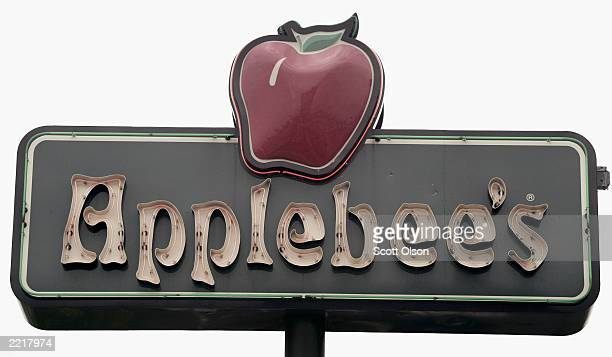 A sign marks the location of an Applebee's restaurant in Chicago Illinois July 28 2003 Applebee's recently announced it would enter a license...