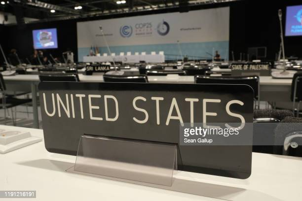 A sign marks the seat of the official delegation of the United States in a plenary hall ahead of the UNFCCC COP25 climate conference on December 1...