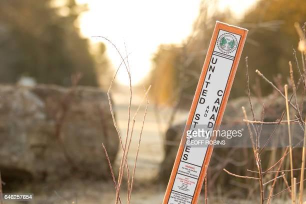 A sign marks the USCanada border near Hemmingford Quebec February 28 2017 / AFP / Geoff Robins