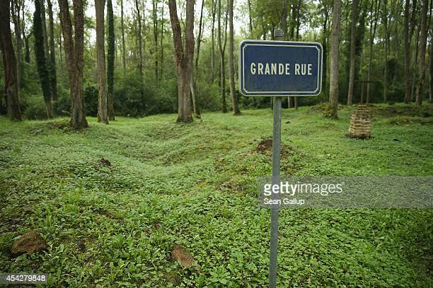 A sign marks where the main street once passed on the site of the former village of Bezonvaux among terrain still pockmarked by World War I artillery...
