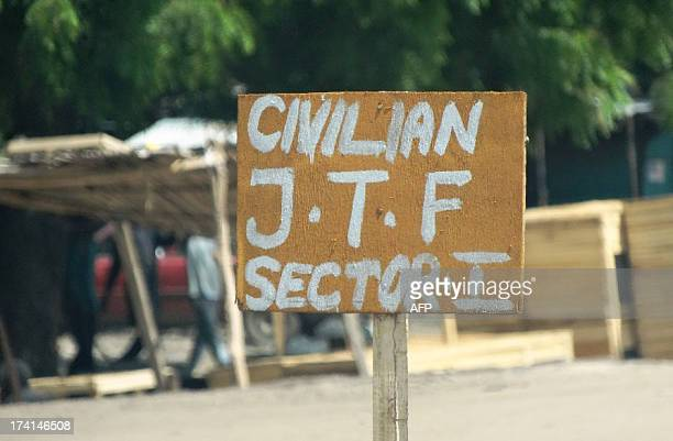 A sign near a checkpoint of a vigilante group reads Civilian JTF or Civilian Joint Task Force on July 19 2013 in Maiduguri where Boko Haram has...