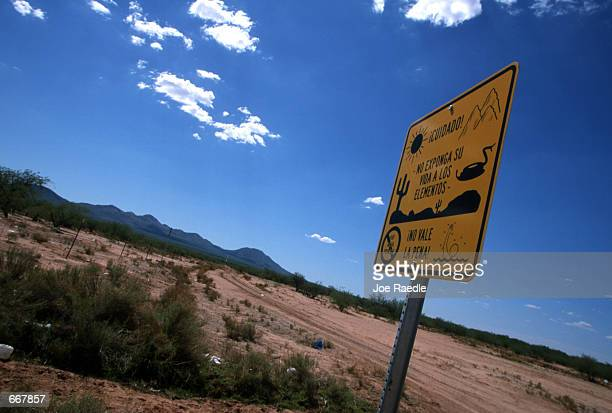 A sign near the barbed wire fence that marks the US/Mexico border warns immigrants July12 2000 that they should not expose themselves to the harsh...