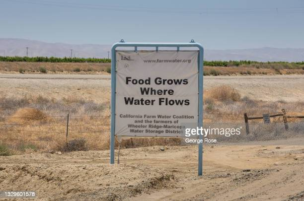 Sign near the California State Aqueduct at the junction of Highway 166 promotes the growing of food on July 7 near Wheeler Ridge, California. Due to...
