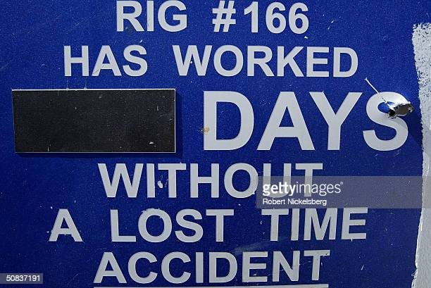 A sign near the floor of a natural gas drilling rig reminds employees about on the job safety May 8 2004 eight miles north of Evanston Wyoming...