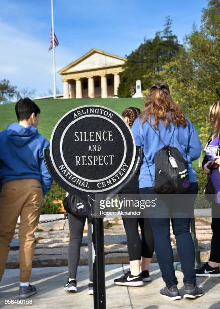 A sign near the grave of former President John F Kennedy at Arlington National Cemetery urges visitors to observe silence and respect for the US...