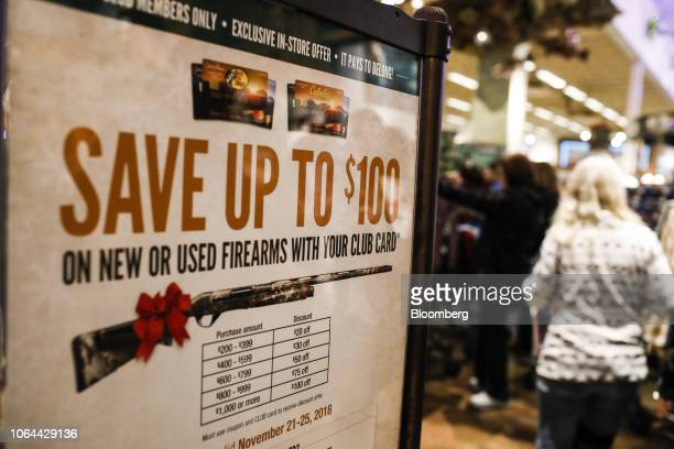 Sign notifies Club Card members of discounts on new or used firearms at a Bass Pro Outdoor World LLC store on Black Friday in Tampa, Florida, U.S.,...