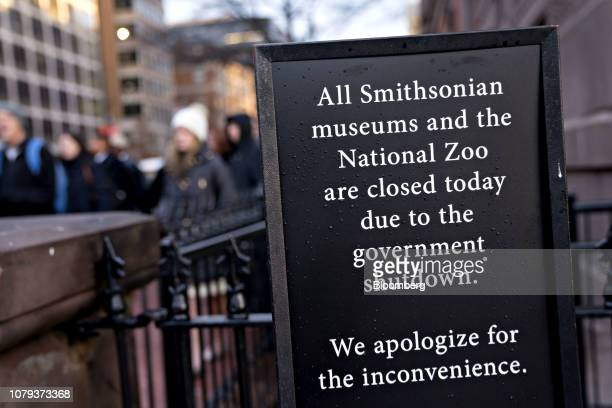 A sign notifying visitors that the Smithsonian museums and the National Zoo are closed due to a partial government shutdown stands outside the...