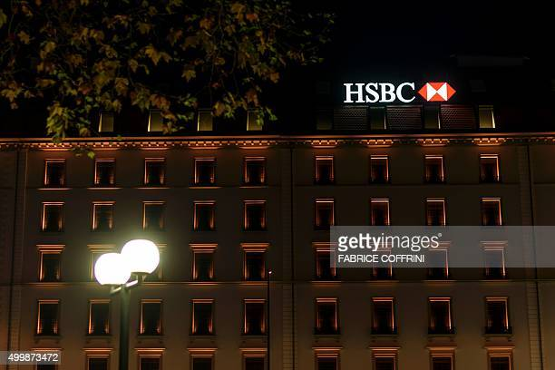A sign of banking giant HSBC is on the top of a branch on late December 2 2015 in Geneva / AFP / FABRICE COFFRINI