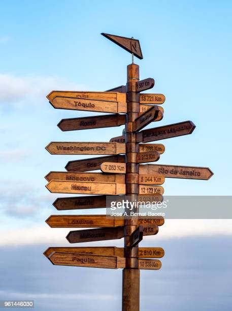 sign of direction, wooden sign board on mountain against clear sky. - richtung stock-fotos und bilder