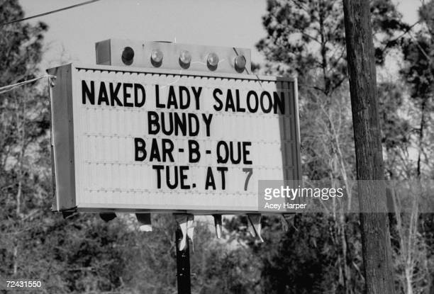 Sign of Naked Lady Saloon celebrating the execution of serial killer Ted Bundy