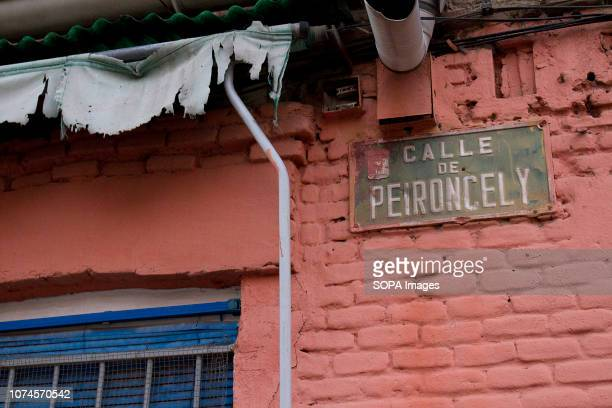 Sign of Peironcely street 10 seen on the wall of a building. In 1936 Robert Capa took an iconic photography of a building in Entrevías quarter, at...