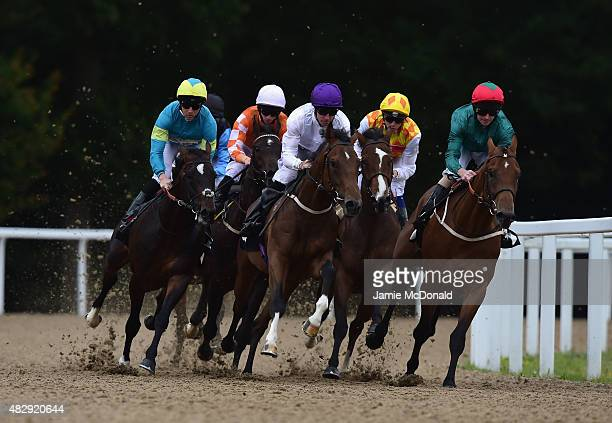 Sign of the Kodiac riden by Tom Eaves wins the Bet toteplacepot Nursery Handicap Stakes during racing at Chelmsford City Racecourse on August 4 2015...