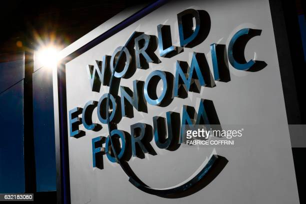 A sign of the World Economic Forum is seen on the closing day of the forum on January 20 2017 in Davos / AFP PHOTO / FABRICE COFFRINI