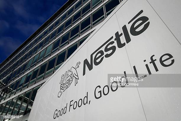 A sign of the world's biggest food company Nestle is seen at their headquarters on October 17 2013 in Vevey The turnover of the Swiss group Nestle...