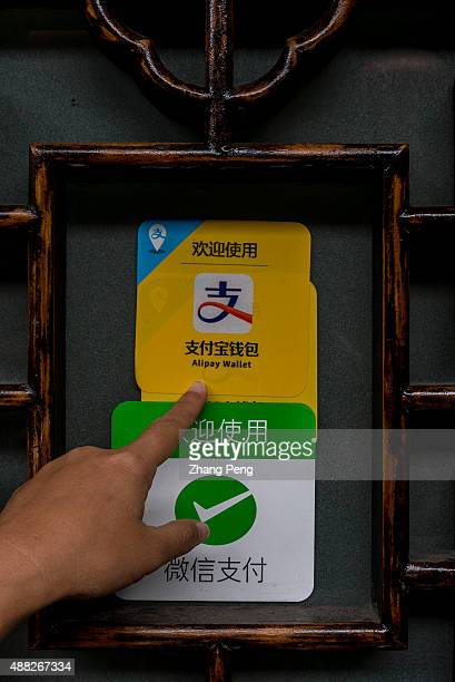 Sign of 'Welcome to use Alipay' on a shop's window Alipay is China's leading online thirdparty payment service provider under ecommerce giant Alibaba...