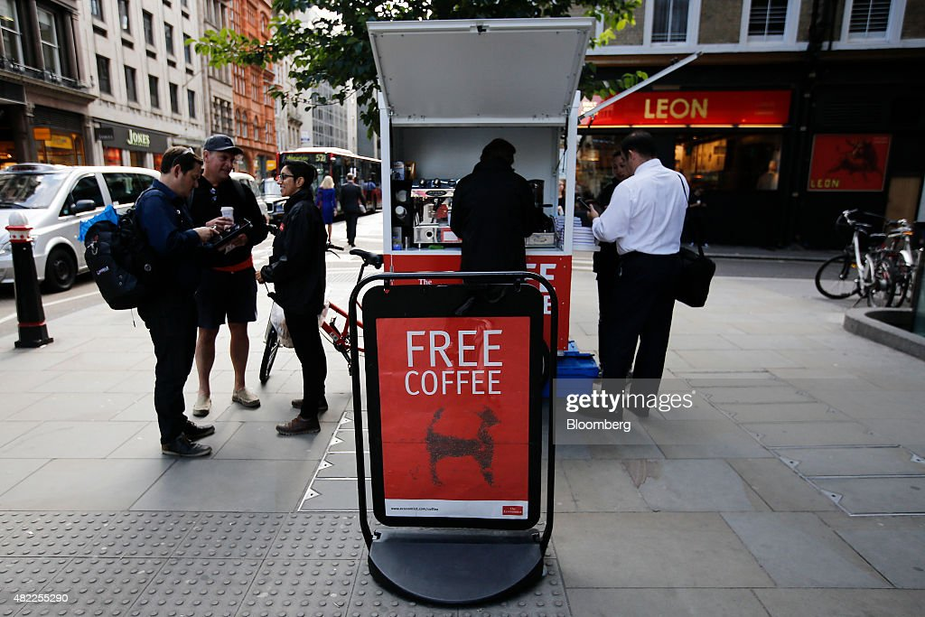 Economist Magazine Vendor Gives Away Promotional Cups Of Kopi Luwak Civet Coffee As Pearson Plc Plan Stake Disposal