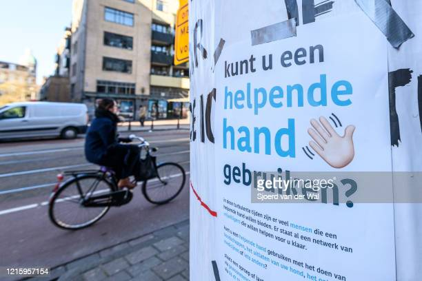 Sign offering help to those who need assistance during self isolation situation following the advice of the Dutch government to stay at home for...