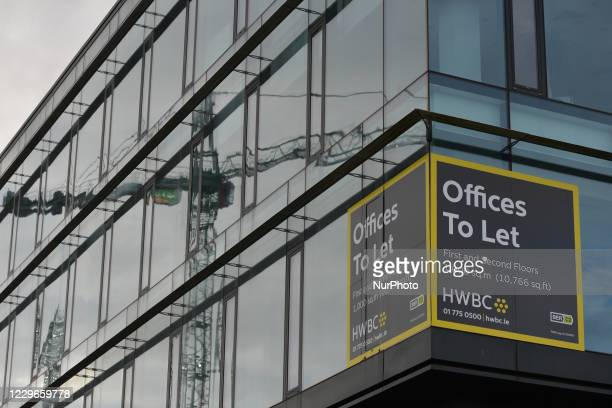 Sign 'Offices To Let' near to an ongoing construction site in Grand Canal Docks area. On Tuesday, November 17 in Dublin, Ireland.