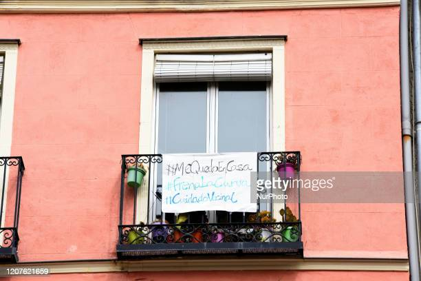 Sign on a balcony in the neighborhood of Lavapiés: `I stay at home, slows down the curve, Neighborhood care in Madrid, Spain on March 18, 2020.