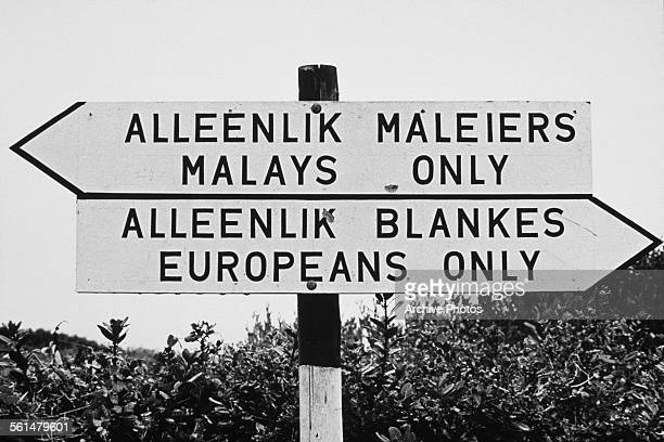 A sign on a beach in Port Elizabeth South Africa during the era of apartheid circa 1960 It reads 'Alleenlik Maleiers Malays Only' and 'Alleenlik...