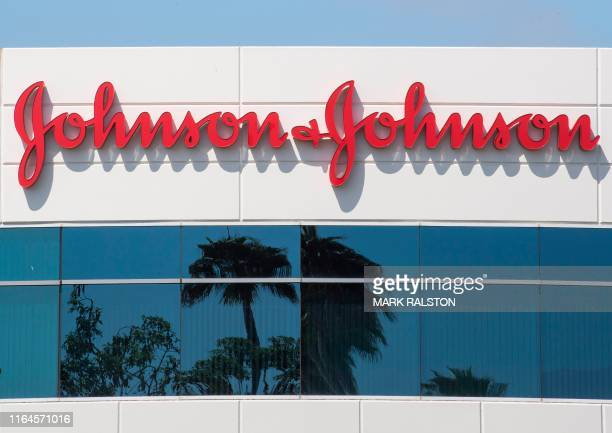 Sign on a building at the Johnson & Johnson campus shows their logo in Irvine, California on August 28, 2019. - The US pharmaceutical industry faces...