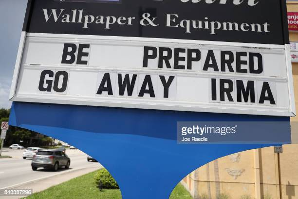A sign on a business reas 'Be Prepared Go Away Irma' as people prepare for the arrival of Hurricane Irma on September 6 2017 in Miami Florida It's...
