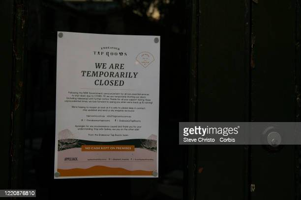 Sign on a door in the Rocks district tells of closure on March 26, 2020 in Sydney, Australia. Further restrictions on travel and movement have been...