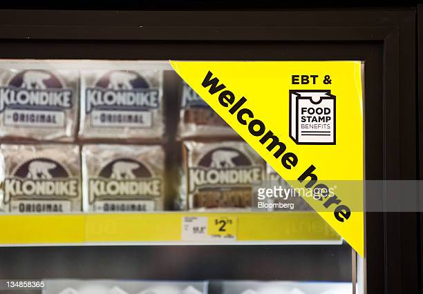 A sign on a frozen food case indicates that Electronic Benefit Transfer and food stamps are accepted at the Dollar General Corp store in Saddle Brook...