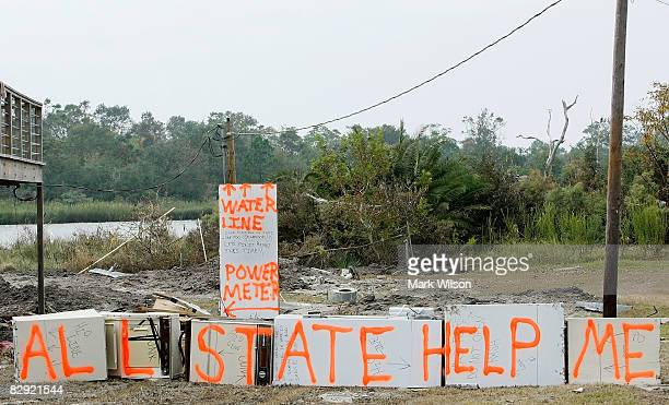 A sign on a home damaged by Hurricane Ike reads 'Allstate Help Me' September 19 2008 in Seabrook Texas Hurricane Ike caused wide spread damage and...