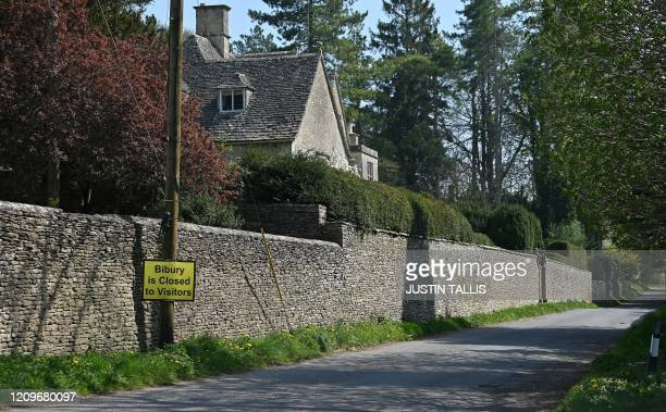 """Sign on a lamppost outside a village advises approaching motorists that Bibury Village is """"Closed to Visitors"""" in the Cotswolds in western England,..."""