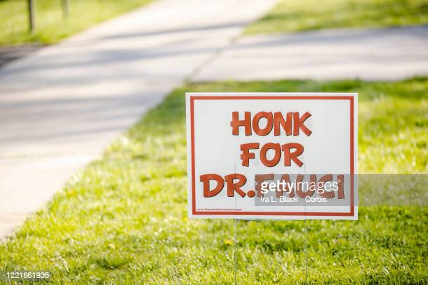 A sign on a lawn says Honk for Dr Fauci to show support for Dr Anthony S Fauci MD director of the National Institute of Allergy and Infectious...