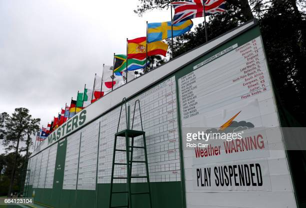 A sign on a leaderboard indicates that play is suspended due to inclement weather during a practice round prior to the start of the 2017 Masters...