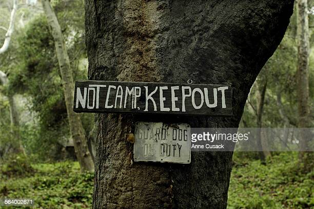 A sign on a oak tree on the Kronsberg property Jeremy Joe Kronsberg and his wife Lynne Kronsberg live in this stone cabin with their dog Chagall He...