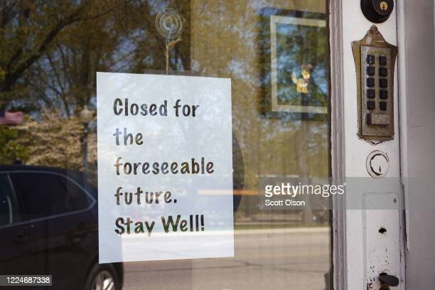 Sign on a storefront lets residents know the business remains closed on May 13, 2020 in Chesterton, Indiana. Recently, Indiana began allowing some...