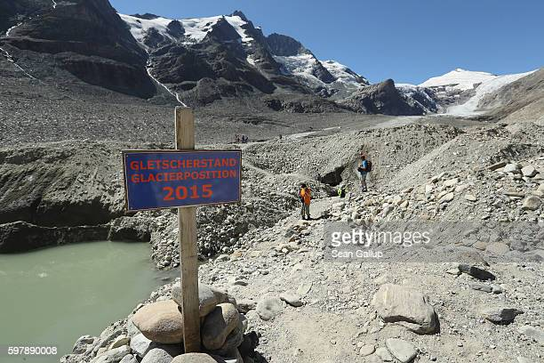 A sign on a trail that leads to the melting and rockcovered Pasterze glacier indicates where the foot of the glacier reached in 2015 on August 27...