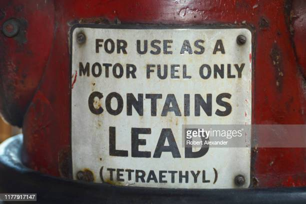Sign on a vintage gasoline pump advises that the gas contains lead .