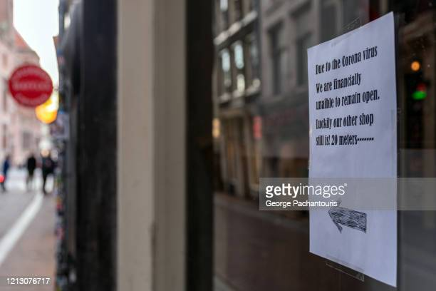 sign on a window shop which is closed due to corona virus - government shutdown stock pictures, royalty-free photos & images