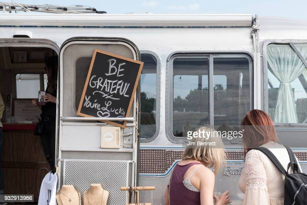 A sign on an airstream trailer boutique encourages patrons to be grateful at the Luck Reunion held on Willie Nelson's ranch on March 15 2018 in...