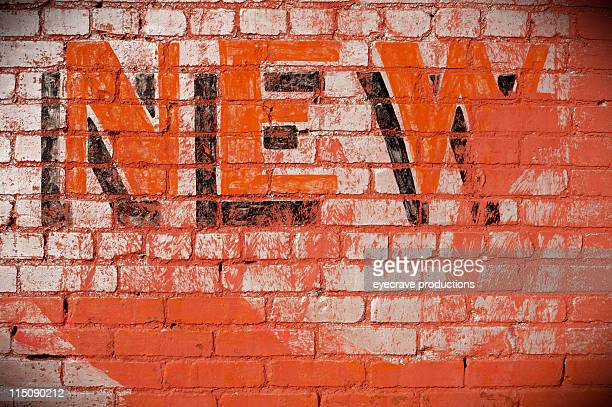 sign on brick wall - new - single word stock pictures, royalty-free photos & images